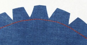 The hem (the red stitches)